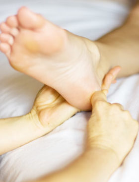 A patient's foot receiving treatment from a podiatrist